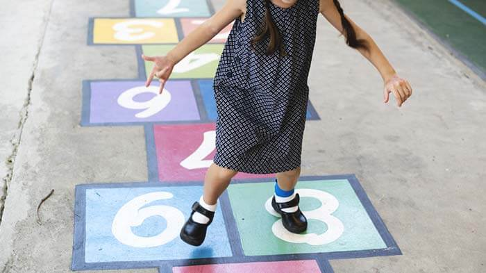 The girl playing hopscotch